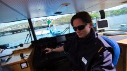 Kapináka lodní dopravy / River cruise captain